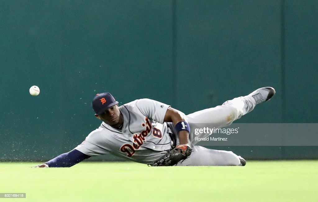 Justin Upton #8 of the Detroit Tigers dives for a rbi single by Nomar Mazara #30 of the Texas Rangers in the fourth inning at Globe Life Park in Arlington on August 15, 2017 in Arlington, Texas.