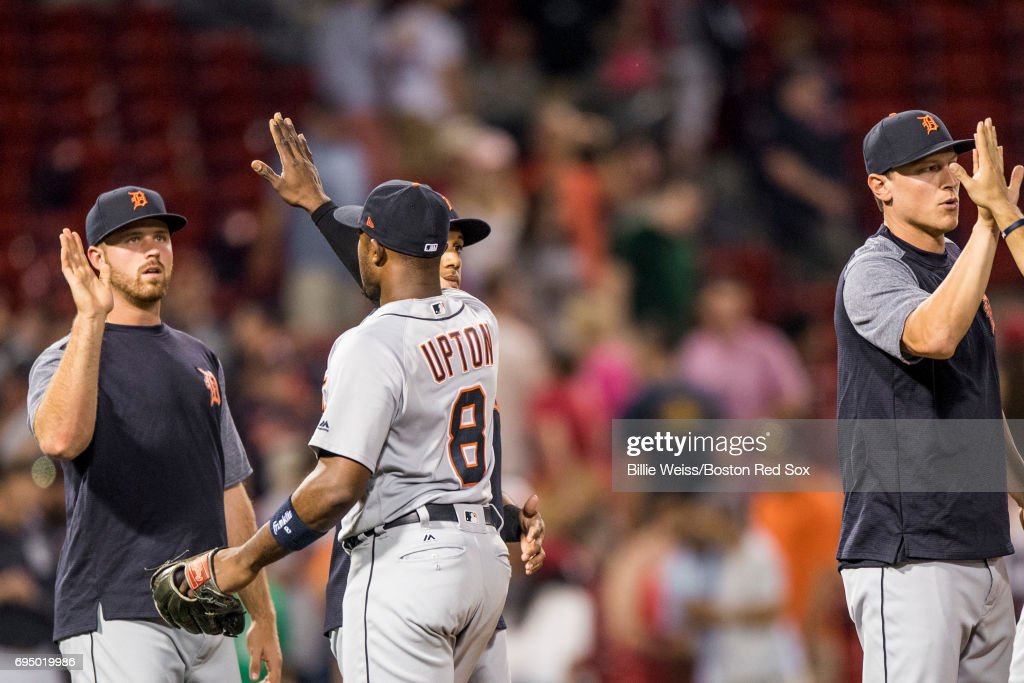 Justin Upton #8 of the Detroit Tigers high fives teammates after a game against the Boston Red Sox on June 11, 2017 at Fenway Park in Boston, Massachusetts.