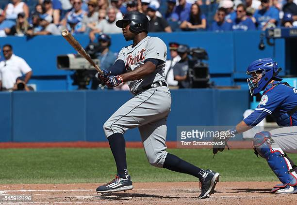 Justin Upton of the Detroit Tigers hits a single in the ninth inning during MLB game action against the Toronto Blue Jays on July 10 2016 at Rogers...