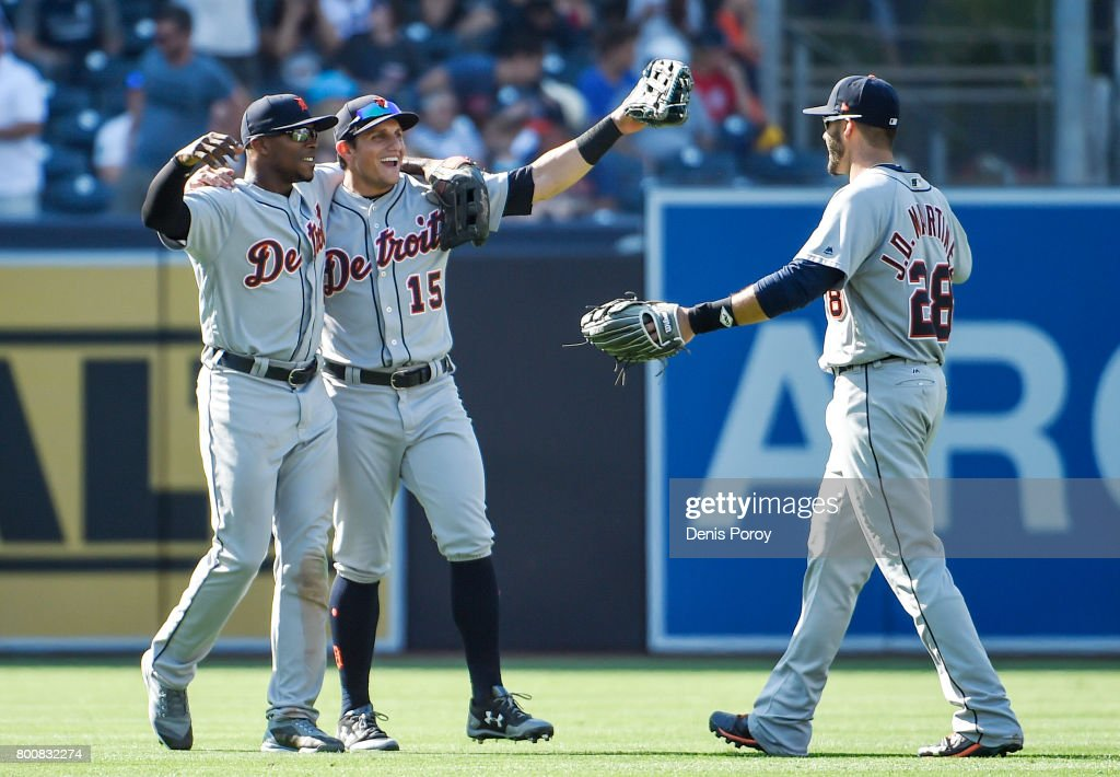Justin Upton #8 of the Detroit Tigers, left, Mikie Mahtook #15, center, and J.D. Martinez #28 celebrate after beating the San Diego Padres 7-5 in a baseball game at PETCO Park on June 25, 2017 in San Diego, California.