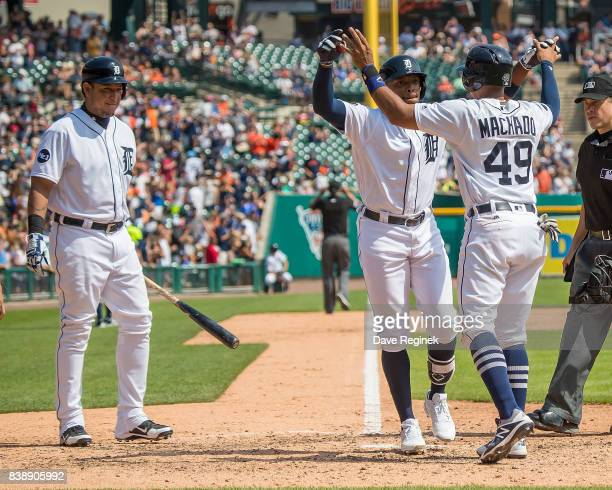 Justin Upton of the Detroit Tigers slaps hands with Dixon Machado after his two run home run in the sixth inning against the Los Angeles Dodgers...