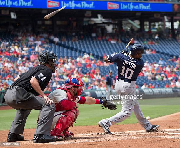 Justin Upton of the San Diego Padres breaks his bat in the top of the first inning against the Philadelphia Phillies on August 30 2015 at the...