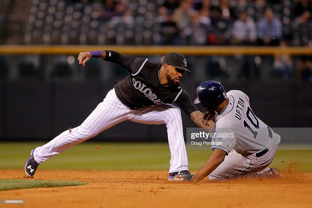 <a gi-track='captionPersonalityLinkClicked' href=/galleries/search?phrase=Justin+Upton&family=editorial&specificpeople=846265 ng-click='$event.stopPropagation()'>Justin Upton</a> #10 of the San Diego Padres slides safelly into second base as shortstop <a gi-track='captionPersonalityLinkClicked' href=/galleries/search?phrase=Jose+Reyes+-+Baseball+Player&family=editorial&specificpeople=203307 ng-click='$event.stopPropagation()'>Jose Reyes</a> #7 of the Colorado Rockies takes the throw after a fielding error by Carlos Gonzalez #5 of the Colorado Rockies on a pop fly by Melvin Upton Jr. #2 of the San Diego Padres in the second inning at Coors Field on September 18, 2015 in Denver, Colorado.