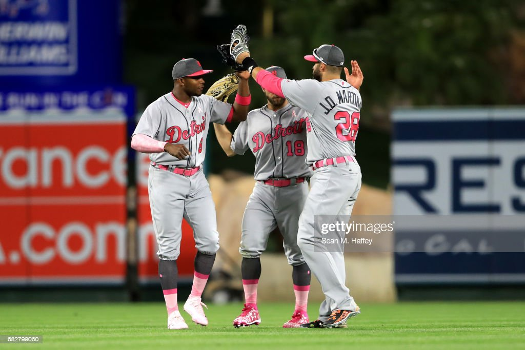 Justin Upton #8, Tyler Collins #18 and J.D. Martinez #28 of the Detroit Tigers celebrate defeating the Los Angeles Angels of Anaheim 4-3 in a game at Angel Stadium of Anaheim on May 13, 2017 in Anaheim, California.