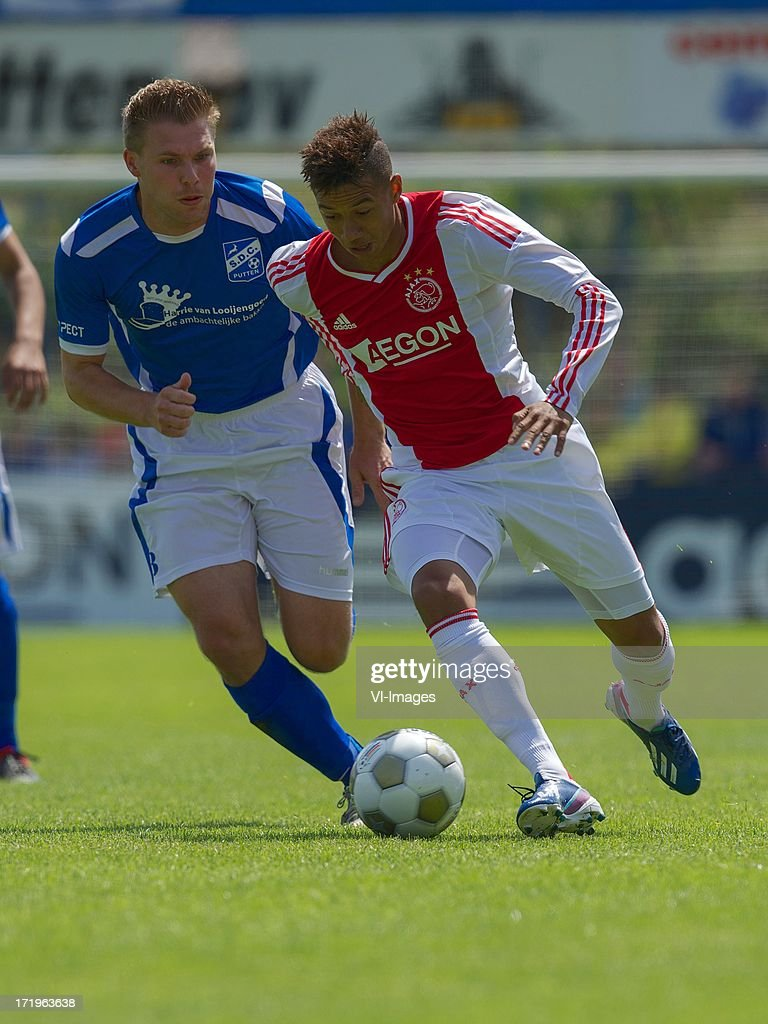 Justin van Groen of SDC Putten, Tobias Sana of Ajax during the pre season friendly match between SDC Putten and Ajax on June 29, 2013 in Putten, The Netherlands.