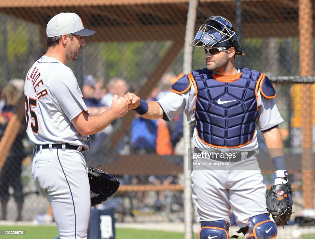 Justin Verlander #35 and Alex Avila #13 of the Detroit Tigers fist-bump during Spring Training workouts at the TigerTown Facility on February 20, 2013 in Lakeland, Florida.