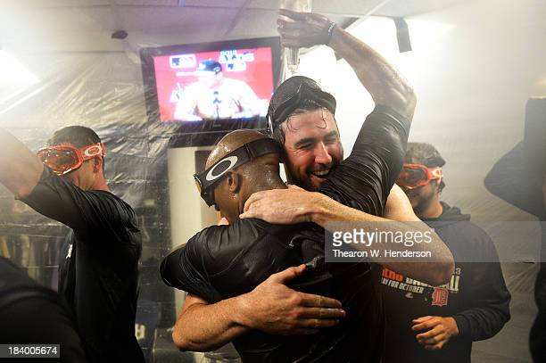 Justin Verlander and Austin Jackson of the Detroit Tigers celebrate their 3 to 0 win over the Oakland Athletics in the locker room after Game Five of...