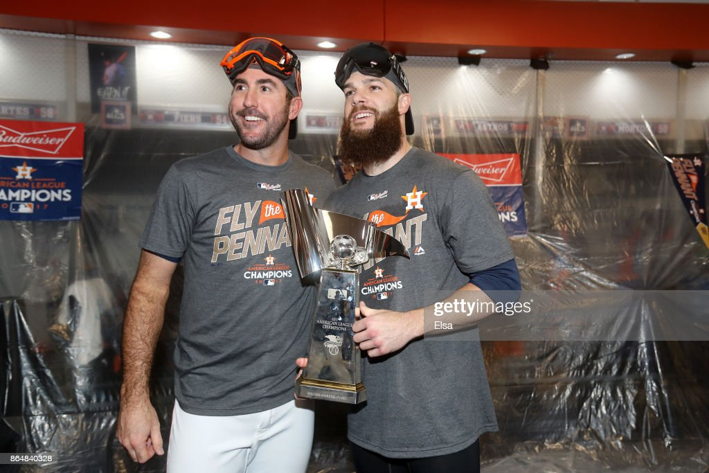 Justin Verlander #35 and Dallas Keuchel #60 of the Houston Astros celebrate with the William Harridge Trophy in the locker room after defeating the New York Yankees by a score of 4-0 to win Game Seven of the American League Championship Series at Minute Maid Park on October 21, 2017 in Houston, Texas. The Houston Astros advance to face the Los Angeles Dodgers in the World Series.