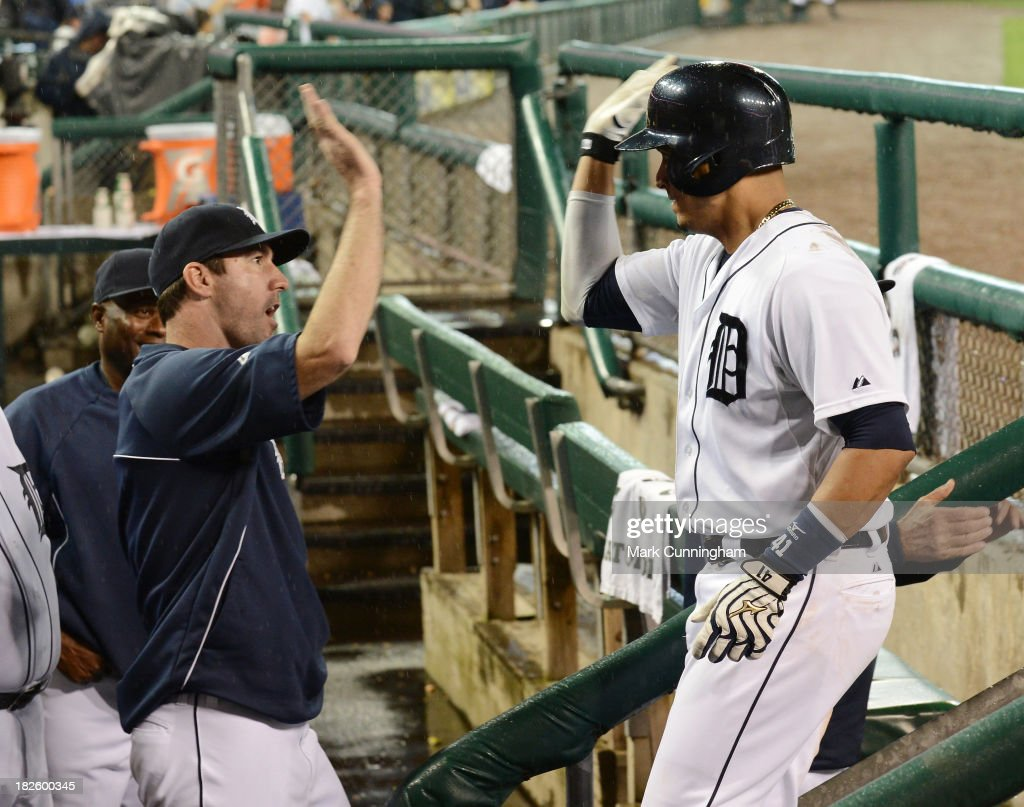 Justin Verlander #35 and Victor Martinez #41 of the Detroit Tigers high-five in the dugout during the game against the Chicago White Sox at Comerica Park on September 20, 2013 in Detroit, Michigan. The Tigers defeated the White Sox 12-5.