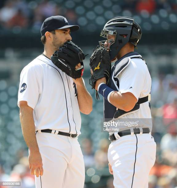 Justin Verlander of the Detroit Tigers and James McCann talk on the mound during the second inning of the game against the Boston Red Sox on April 10...