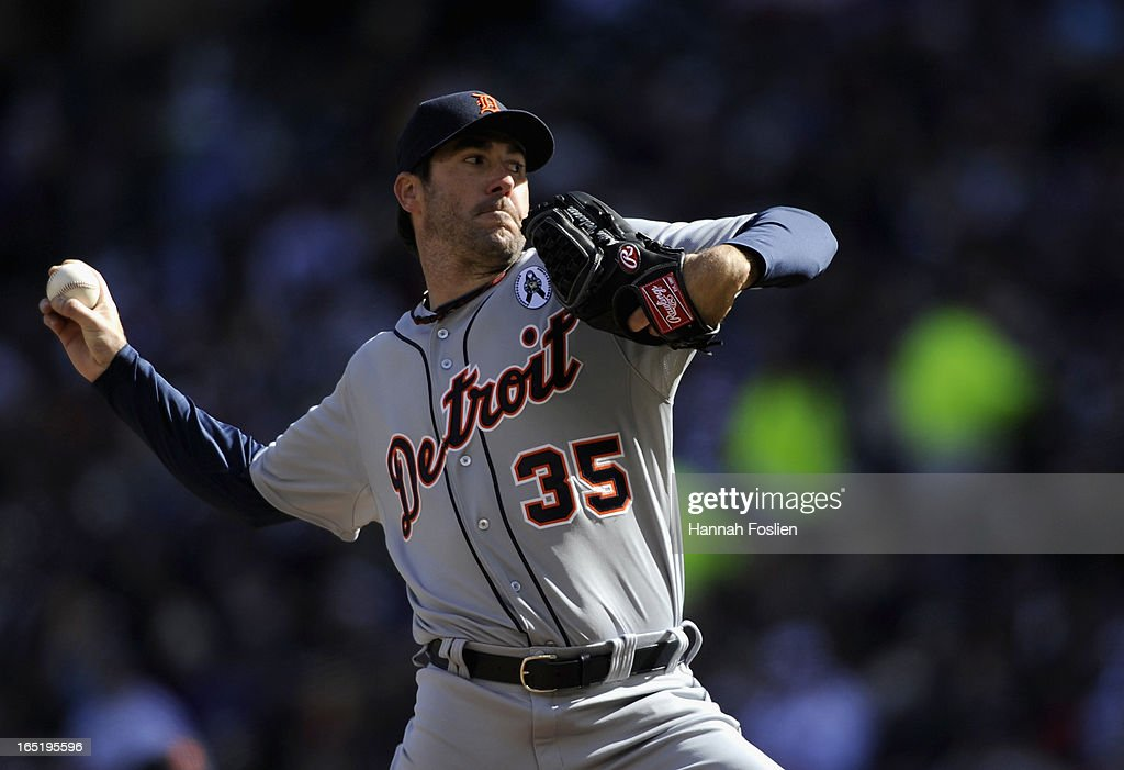 Justin Verlander #35 of the Detroit Tigers delivers a pitch against the Minnesota Twins during the first inning of the Opening Day game on April 1, 2013 at Target Field in Minneapolis, Minnesota.