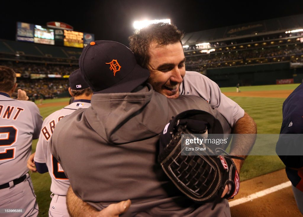 <a gi-track='captionPersonalityLinkClicked' href=/galleries/search?phrase=Justin+Verlander&family=editorial&specificpeople=556723 ng-click='$event.stopPropagation()'>Justin Verlander</a> #35 of the Detroit Tigers is congratulated by teammates after the Detroit Tigers beat the Oakland Athletics in Game Five of the American League Division Series at Oakland-Alameda County Coliseum on October 9, 2012 in Oakland, California.