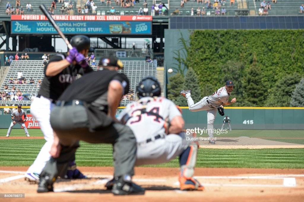 Justin Verlander #35 of the Detroit Tigers pitches against Nolan Arenado #28 of the Colorado Rockies in the first inning of a game at Coors Field on August 30, 2017 in Denver, Colorado.