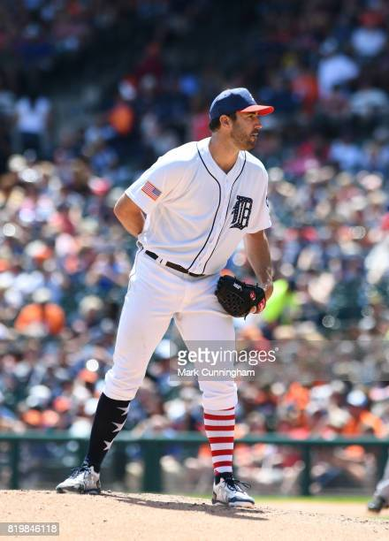 Justin Verlander of the Detroit Tigers pitches while wearing a special red white and blue jersey hat and socks in honor of Independence Day Weekend...