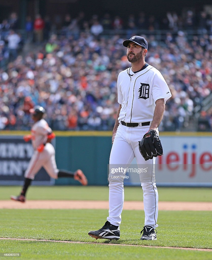 Justin Verlander #35 of the Detroit Tigers reacts after giving up a sacrifice fly to Adam Jones #10 of the Baltimore Orioles scoring Nick Markakis #21 during the eighth inning of the game against the Detroit Tigers at Comerica Park on April 6, 2014 in Detroit, Michigan. The Orioles defeated the Tigers 3-1.