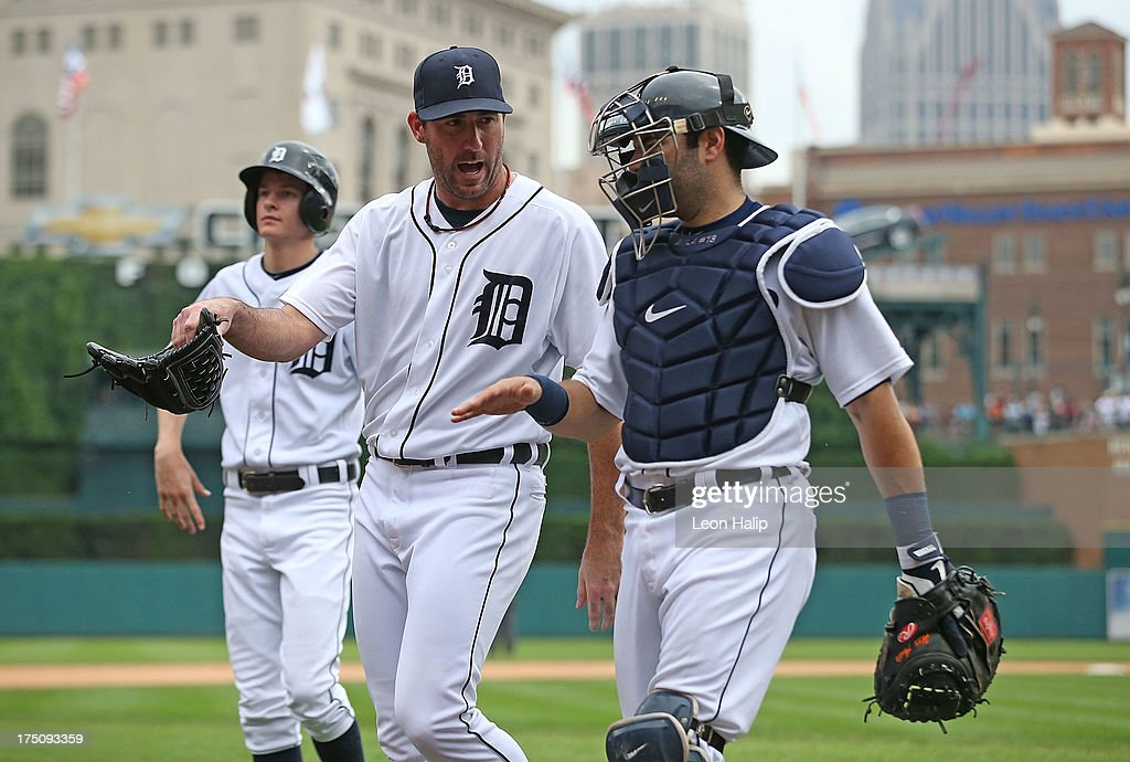 <a gi-track='captionPersonalityLinkClicked' href=/galleries/search?phrase=Justin+Verlander&family=editorial&specificpeople=556723 ng-click='$event.stopPropagation()'>Justin Verlander</a> #35 of the Detroit Tigers talks with catcher <a gi-track='captionPersonalityLinkClicked' href=/galleries/search?phrase=Alex+Avila&family=editorial&specificpeople=5749211 ng-click='$event.stopPropagation()'>Alex Avila</a> #13 during the game against the Washington Nationals at Comerica Park on July 31, 2013 in Detroit, Michigan. The Tigers defeated the Nationals 11-1.