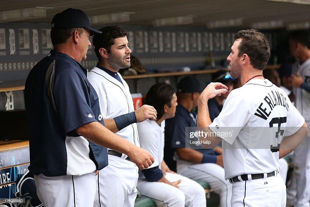 <a gi-track='captionPersonalityLinkClicked' href=/galleries/search?phrase=Justin+Verlander&family=editorial&specificpeople=556723 ng-click='$event.stopPropagation()'>Justin Verlander</a> #35 of the Detroit Tigers talks with pitching coach Jeff Jones #51 and catcher <a gi-track='captionPersonalityLinkClicked' href=/galleries/search?phrase=Alex+Avila&family=editorial&specificpeople=5749211 ng-click='$event.stopPropagation()'>Alex Avila</a> #13 in the dugout during the game against the Washington Nationals at Comerica Park on July 31, 2013 in Detroit, Michigan. The Tigers defeated the Nationals 11-1.