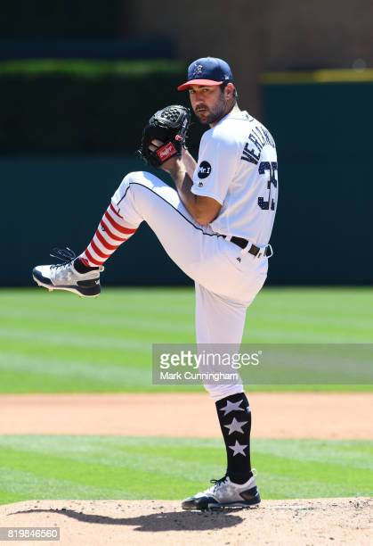 Justin Verlander of the Detroit Tigers throws a warmup pitch while wearing a special red white and blue jersey hat and socks in honor of Independence...
