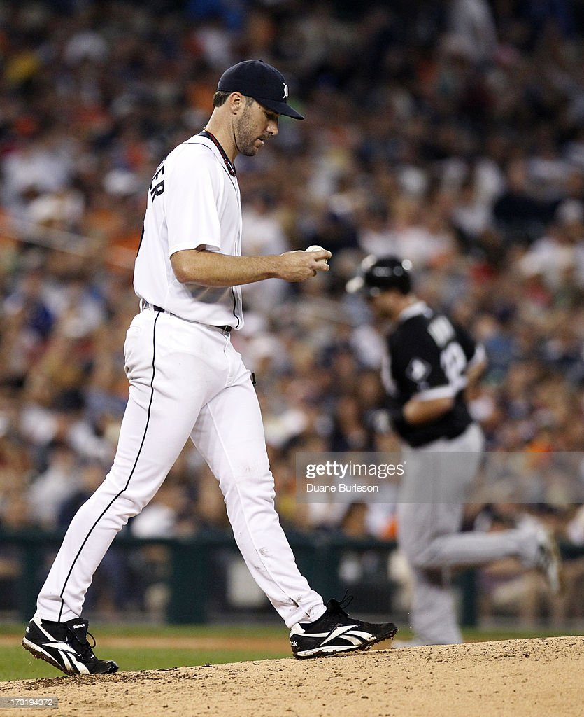 <a gi-track='captionPersonalityLinkClicked' href=/galleries/search?phrase=Justin+Verlander&family=editorial&specificpeople=556723 ng-click='$event.stopPropagation()'>Justin Verlander</a> #35 of the Detroit Tigers walks back to the mound after giving up a two-run home run to <a gi-track='captionPersonalityLinkClicked' href=/galleries/search?phrase=Adam+Dunn&family=editorial&specificpeople=213505 ng-click='$event.stopPropagation()'>Adam Dunn</a> #32 of the Chicago White Sox, right, in the eighth inning at Comerica Park on July 9, 2013 in Detroit, Michigan.