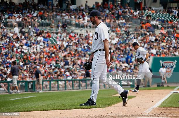Justin Verlander of the Detroit Tigers walks to the dugout after the final out of the fifth inning that saw the Toronto Blue Jays score six runs at...