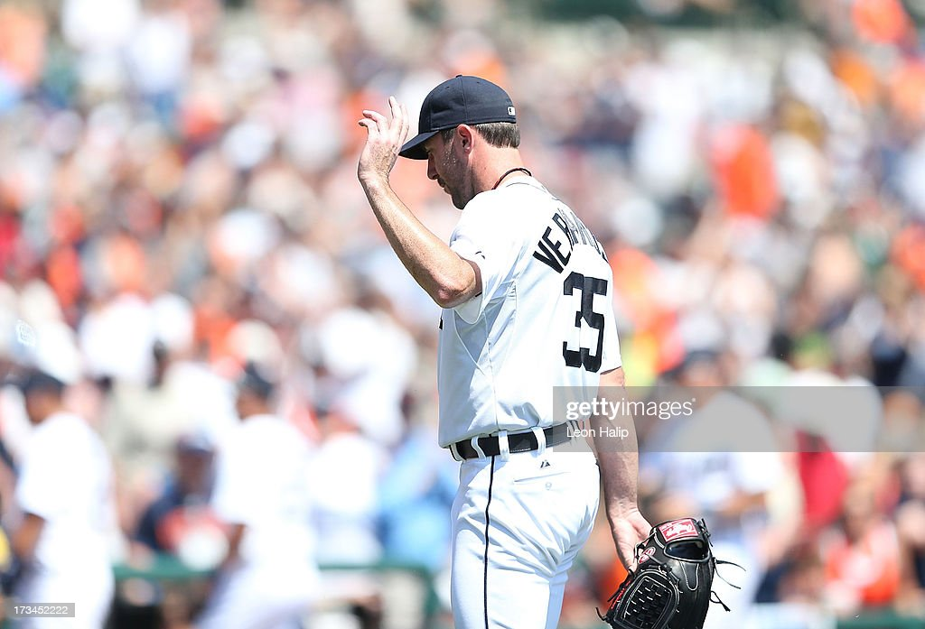 <a gi-track='captionPersonalityLinkClicked' href=/galleries/search?phrase=Justin+Verlander&family=editorial&specificpeople=556723 ng-click='$event.stopPropagation()'>Justin Verlander</a> #35 of the Detroit Tigers waves to the fans after leaving the game in the eighth inning after giving up one hit during the game against the Texas Rangers at Comerica Park on July 14, 2013 in Detroit, Michigan. The Tigers defeated the Rander 5-0.