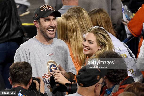 Justin Verlander of the Houston Astros celebrates with fiancee Kate Upton after the Astros defeated the Los Angeles Dodgers 51 in game seven to win...