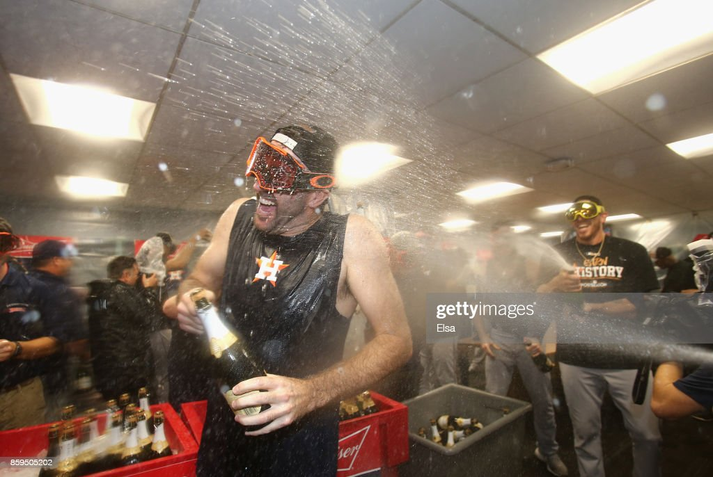 Justin Verlander #35 of the Houston Astros celebrates with teammates in the clubhouse after defeating the Boston Red Sox 5-4 in game four of the American League Division Series at Fenway Park on October 9, 2017 in Boston, Massachusetts. The Astros advance to the American League Championship Series.