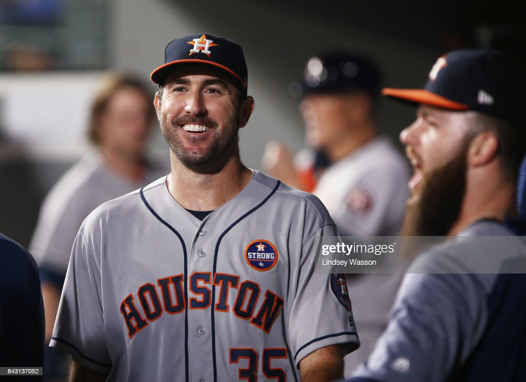 Justin Verlander #35 of the Houston Astros smiles in the dugout after finishing the sixth inning against the Seattle Mariners only giving up only one run at Safeco Field on September 5, 2017 in Seattle, Washington.