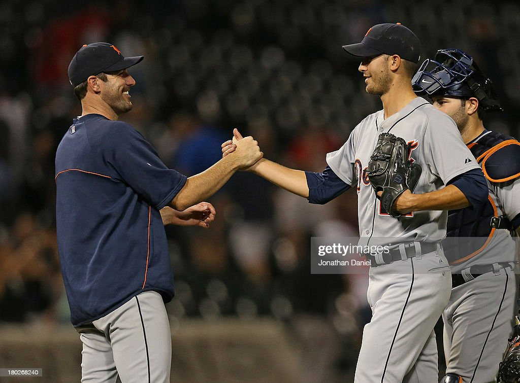 <a gi-track='captionPersonalityLinkClicked' href=/galleries/search?phrase=Justin+Verlander&family=editorial&specificpeople=556723 ng-click='$event.stopPropagation()'>Justin Verlander</a> #35 of the the Detroit Tigers (L) congratulates <a gi-track='captionPersonalityLinkClicked' href=/galleries/search?phrase=Rick+Porcello&family=editorial&specificpeople=4495644 ng-click='$event.stopPropagation()'>Rick Porcello</a> #21 after Porcello's complete game win over the Chicago White Sox at U.S. Cellular Field on September 10, 2013 in Chicago, Illinois. The Tigers defeated the White Sox 9-1.