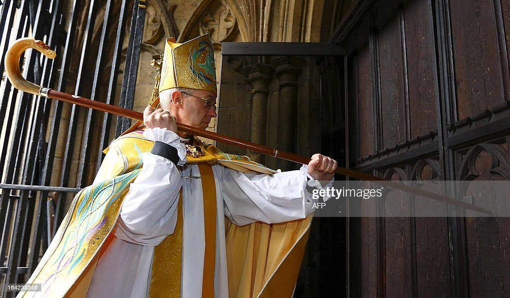 Justin Welby strikes three times on the West Door of Canterbury Cathedral with his pastoral staff prior to his enthronement service to become Archbishop of Canterbury at Canterbury Cathedral in Kent, south-east England, on March 21, 2013.