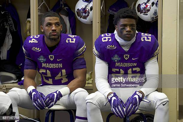 Justin Wellons and Curtis Oliver of James Madison University prepare to take on Youngstown State University during the Division I FCS Football...