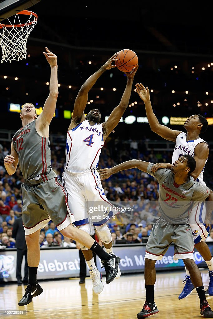 Justin Wesley #4 of the Kansas Jayhawks grabs a rebound during the CBE Hall of Fame Classic game against the Washington State Cougars at Sprint Center on November 19, 2012 in Kansas City, Missouri.