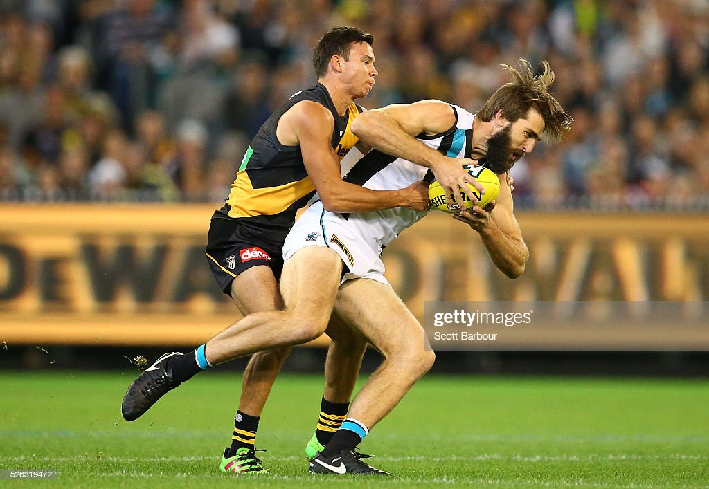 Justin Westhoff of the Power is tackled by Daniel Rioli of the Tigers during the round six AFL match between the Richmond Tigers and the Port Adelaide Power at Melbourne Cricket Ground on April 30, 2016 in Melbourne, Australia.