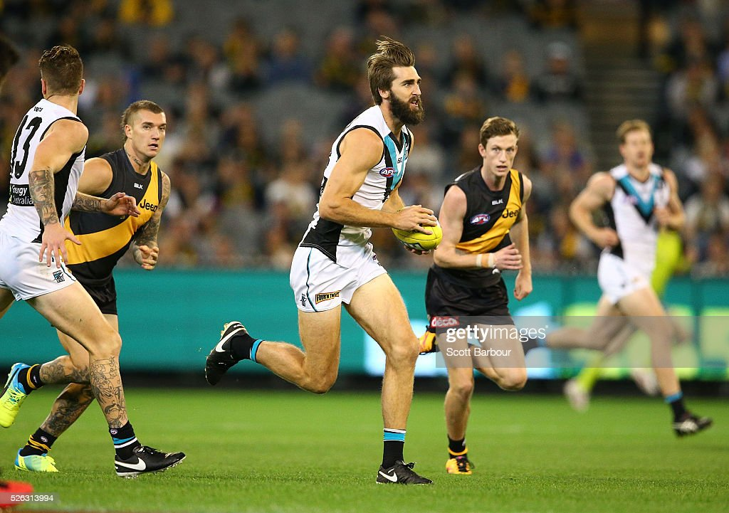Justin Westhoff of the Power runs with the ball during the round six AFL match between the Richmond Tigers and the Port Adelaide Power at Melbourne Cricket Ground on April 30, 2016 in Melbourne, Australia.