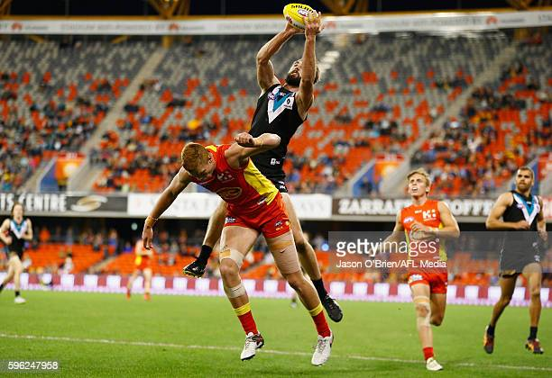 Justin Westhoff of the power takes a mark duringthe round 23 AFL match between the Gold Coast Suns and the Port Adelaide Power at Metricon Stadium on...