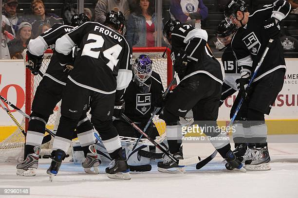 Justin Williams Alexander Frolov Jonathan Quick Wayne Simmonds and Brad Richardson of the Los Angeles Kings warm up prior to the game against the...