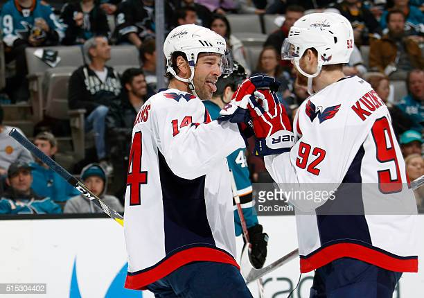 Justin Williams and Evgeny Kuznetsov of the Washington Capitals celebrate after a goal against the San Jose Sharks during a NHL game at the SAP...