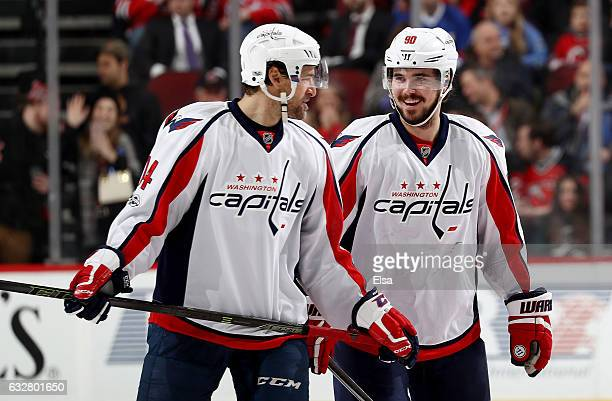 Justin Williams and Marcus Johansson of the Washington Capitals talk during a stop in play against the New Jersey Devils on January 26 2017 at...
