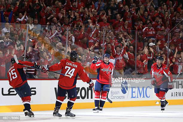Justin Williams and teammates celebrate Jason Chimera's first period goal against the New Jersey Devils at Verizon Center on October 10 2015 in...
