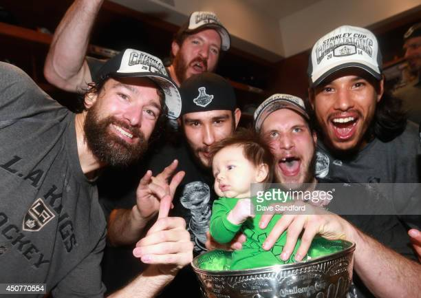 Justin Williams Colin Fraser Slava Voynov Kyle Cliffordand Jordan Nolan of the Los Angeles Kings celebrate with Clifford's baby in the Stanley Cup in...