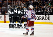 Justin Williams Jeff Carter Slava Voynov Dwight King and Jarret Stoll of the Los Angeles Kings celebrate a goal scored by teammate Willie Mitchell in...