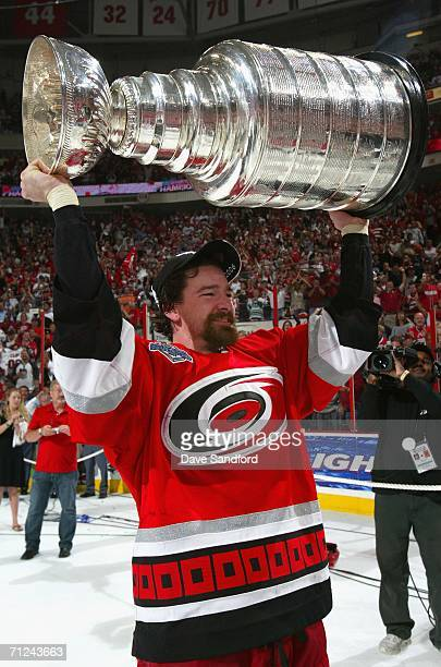 Justin Williams of the Carolina Hurricanes celebrates with the Stanley Cup after defeating the Edmonton Oilers in game seven of the 2006 NHL Stanley...