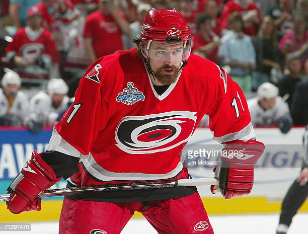 Justin Williams of the Carolina Hurricanes looks on against the Edmonton Oilers during game seven of the 2006 NHL Stanley Cup Finals on June 19 2006...