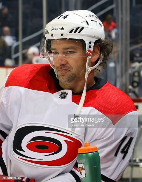 Justin Williams of the Carolina Hurricanes looks on during the pregame warm up prior to NHL action against the Winnipeg Jets at the Bell MTS Place on...