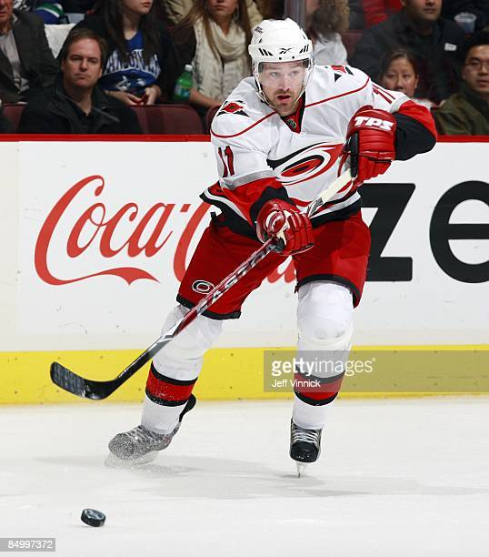 Justin Williams of the Carolina Hurricanes passes the puck up ice during their game against the Vancouver Canucks at General Motors Place on February...