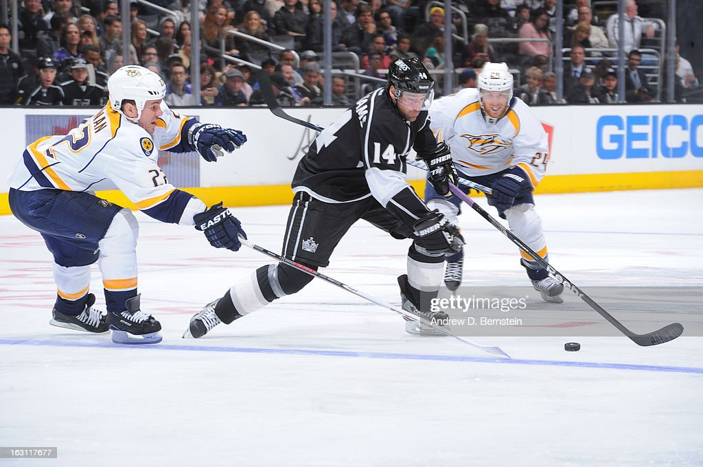 Justin Williams #14 of the Los Angeles Kings battles for the puck against <a gi-track='captionPersonalityLinkClicked' href=/galleries/search?phrase=Scott+Hannan&family=editorial&specificpeople=203195 ng-click='$event.stopPropagation()'>Scott Hannan</a> #22 of the Nashville Predators during a game at Staples Center on March 4, 2013 in Los Angeles, California.