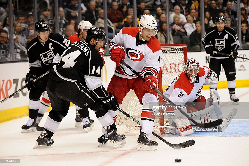 Justin Williams #14 of the Los Angeles Kings battles for the puck against <a gi-track='captionPersonalityLinkClicked' href=/galleries/search?phrase=Andrej+Sekera&family=editorial&specificpeople=722503 ng-click='$event.stopPropagation()'>Andrej Sekera</a> #4 of the Carolina Hurricanes at Staples Center on March 1, 2014 in Los Angeles, California.