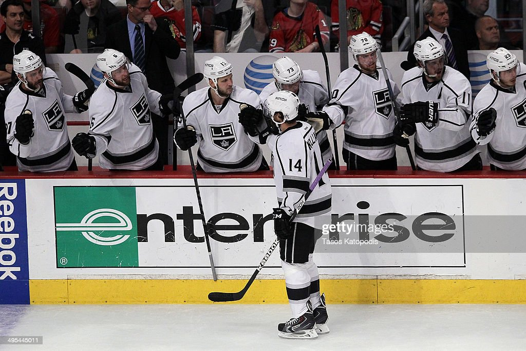 Justin Williams #14 of the Los Angeles Kings celebrates with his teammates after scoring a goal against Corey Crawford #50 of the Chicago Blackhawks in the first period during Game Seven of the Western Conference Final in the 2014 Stanley Cup Playoffs at United Center on June 1, 2014 in Chicago, Illinois.