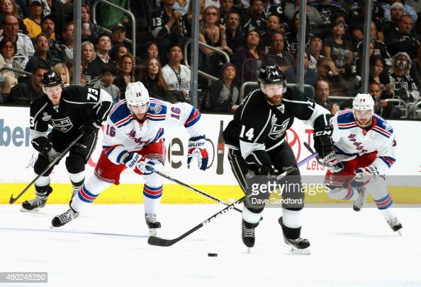 Justin Williams of the Los Angeles Kings is chased by Derick Brassard and Mats Zuccarello of the New York Rangers in the second period of Game Two of...