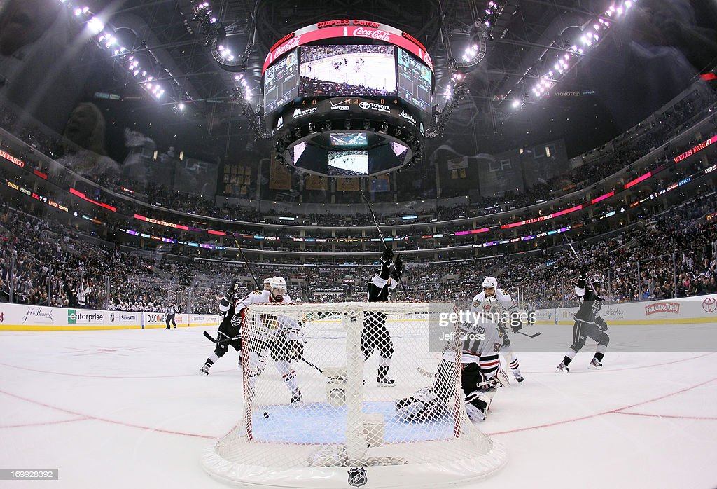 Justin Williams #14 of the Los Angeles Kings (R) reacts after scoring against goaltender <a gi-track='captionPersonalityLinkClicked' href=/galleries/search?phrase=Corey+Crawford&family=editorial&specificpeople=818935 ng-click='$event.stopPropagation()'>Corey Crawford</a> #50 of the Chicago Blackhawks in the first period of Game Three of the Western Conference Final during the 2013 NHL Stanley Cup Playoffs at Staples Center on June 4, 2013 in Los Angeles, California.